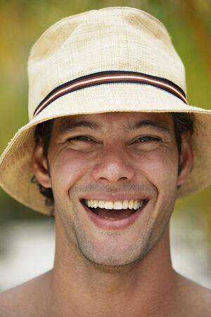 away from it all: South American man wearing hat