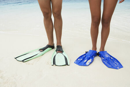 taking the plunge: South American couple wearing flippers LANG_EVOIMAGES