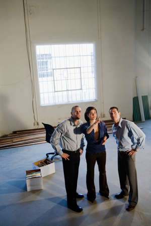 empty warehouse: Young businesspeople in new office