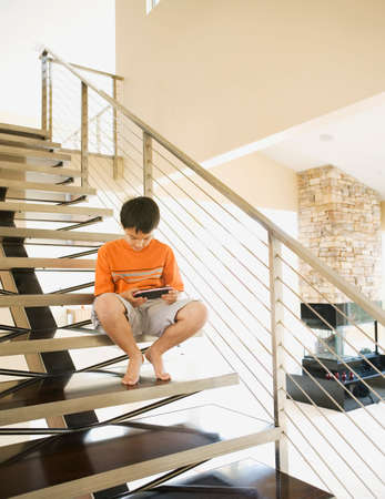 channel surfing: Hispanic boy playing video game