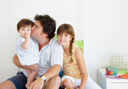 spending full: Hispanic father spending time with daughters