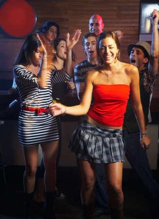 dancing club: Hispanic friends dancing at nightclub LANG_EVOIMAGES