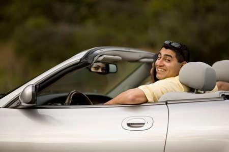 transportation: Hispanic man sitting in convertible car