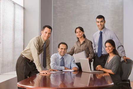 professionalism: Hispanic businesspeople in conference room LANG_EVOIMAGES