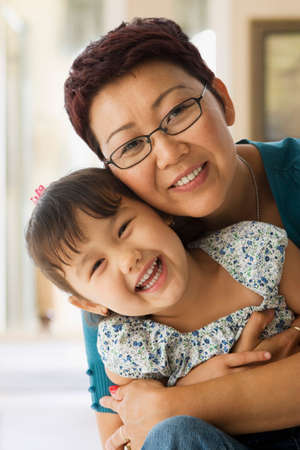 asian ethnicity: Asian mother and daughter hugging