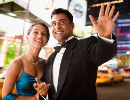 eveningwear: Hispanic couple in eveningwear in urban scene LANG_EVOIMAGES