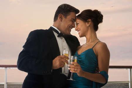 eveningwear: Hispanic couple in eveningwear on ship
