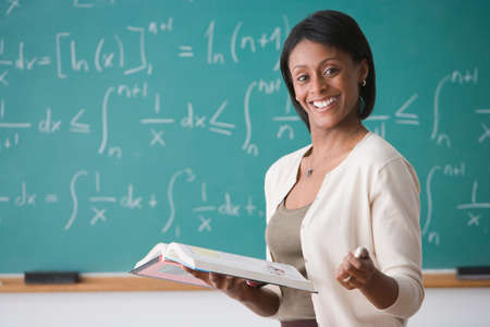 bestowing: African American female teacher holding text book