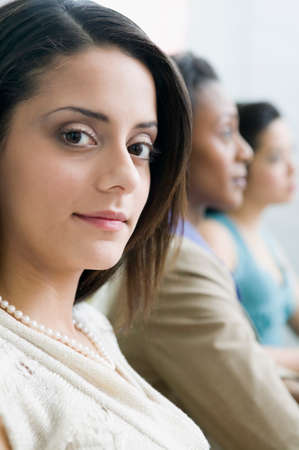 chinese american ethnicity: Multi-ethnic businesswomen at meeting LANG_EVOIMAGES