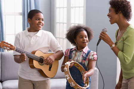 chinese american ethnicity: African American mother and children playing instruments LANG_EVOIMAGES