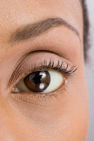 only mid adult women: Close up of African American womans eye