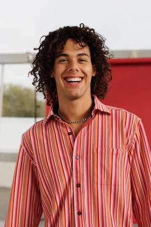 low spirited: Portrait of young Hispanic man