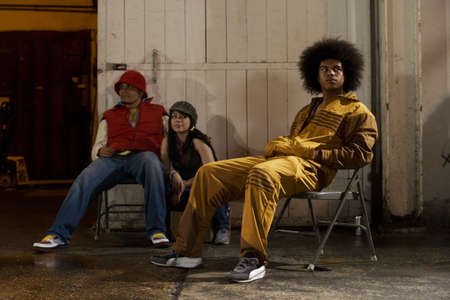 jamaican adult: Multi-ethnic breakdancers in warehouse