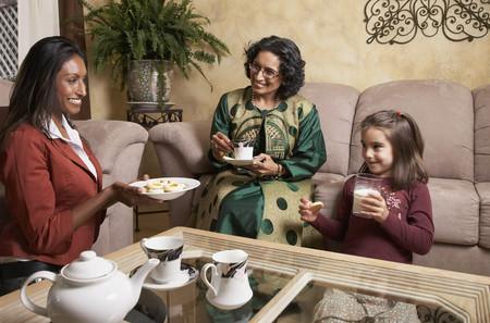 three generations of women: Multi-generational Indian female family members having snack LANG_EVOIMAGES
