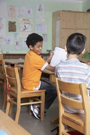 experimentation: Multi-ethnic boys in classroom
