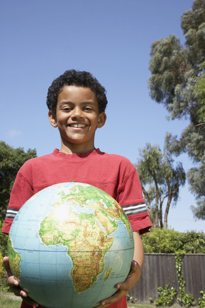 filipino ethnicity: Mixed Race boy holding globe LANG_EVOIMAGES
