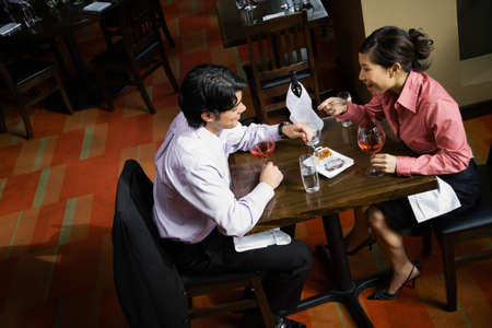 wooing: Asian couple at restaurant