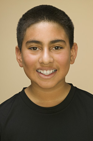 tomboy: Close up of Hispanic boy smiling