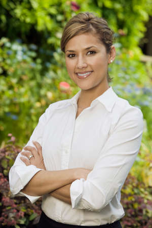 superiority: Hispanic woman with arms crossed