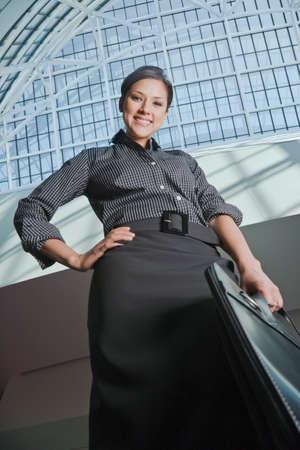 low  angle: Low angle view of Hispanic businesswoman