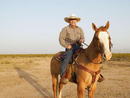 full length herbivore: Mixed Race man riding horse