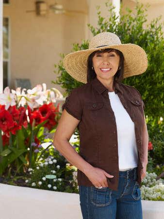 full length herbivore: Hispanic woman wearing sunhat