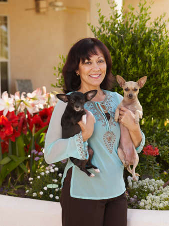 ostentatious: Hispanic woman holding dogs