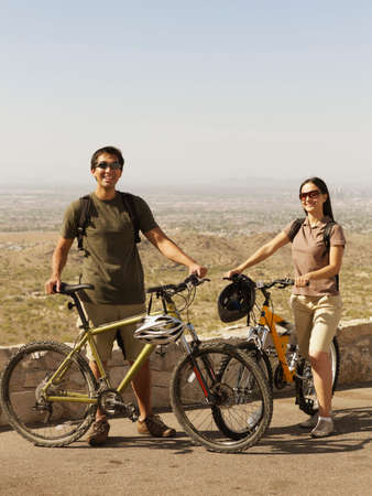 fulfilling: Hispanic couple with bicycles LANG_EVOIMAGES