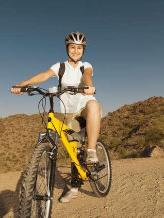 ceasing: Hispanic woman on bicycle