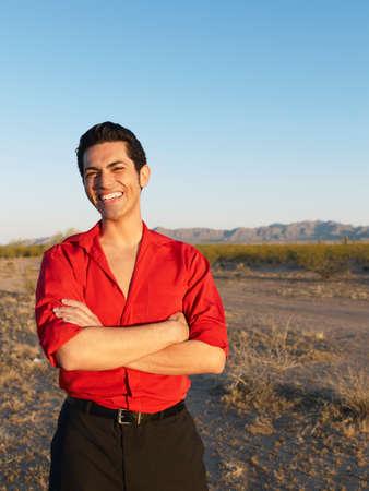 nite: Hispanic man with arms crossed