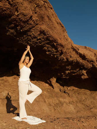inner strength: Senior Hispanic woman practicing yoga LANG_EVOIMAGES