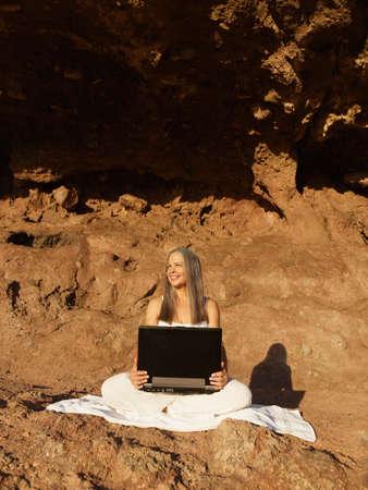 grampa: Senior Hispanic woman holding laptop