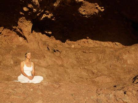talker: Senior Hispanic woman meditating
