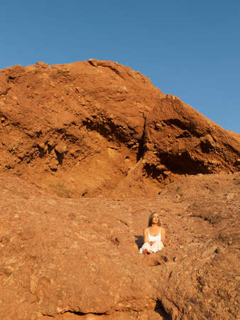 rock formation: Senior Hispanic woman sitting on rock formation