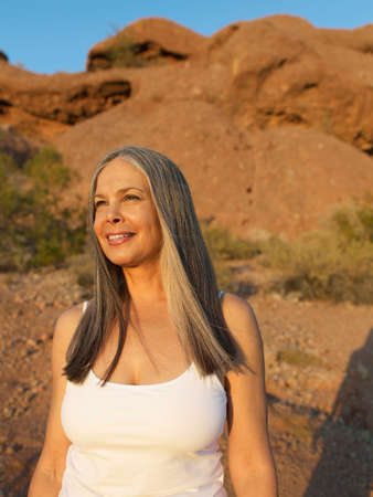 rock formation: Senior Hispanic woman in front of rock formation LANG_EVOIMAGES