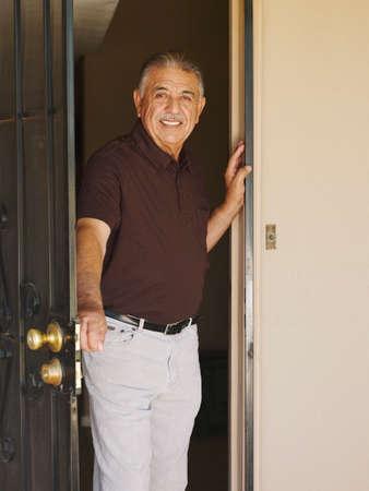 open doorway: Senior Hispanic man in open doorway