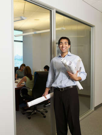 easygoing: Hispanic businessman next to conference room