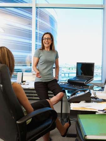 acknowledging: Hispanic businesswomen talking LANG_EVOIMAGES