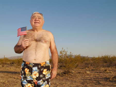 togs: Senior Mixed Race man wearing bathing suit in desert LANG_EVOIMAGES