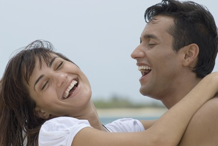 Multi-ethnic couple laughing Stock Photo