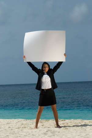 singly: Hispanic businesswoman holding blank sign