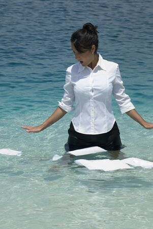 sopping: Hispanic businesswoman with papers in water