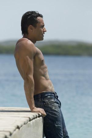 Hispanic man leaning on dock Banco de Imagens