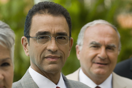 jointly: Portrait of Hispanic businessman