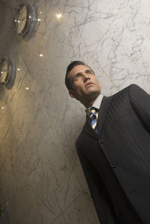 bestowing: Low angle view of Hispanic businessman