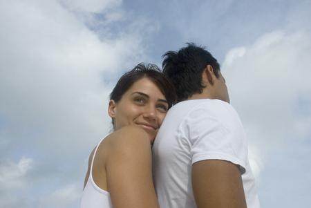 constancy: Multi-ethnic couple hugging