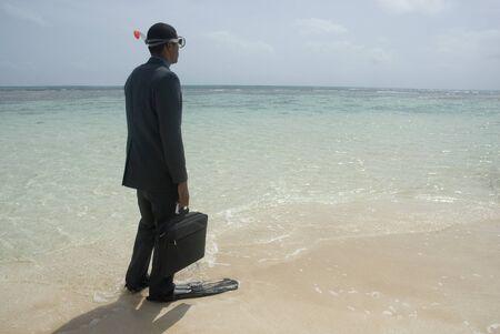 subjugation: Hispanic businessman wearing snorkeling gear