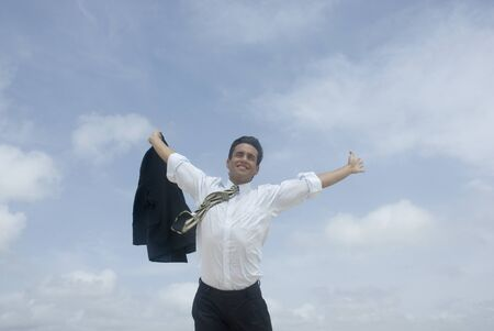 ceasing: Hispanic businessman with arms raised LANG_EVOIMAGES