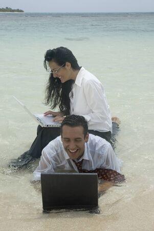 sopping: Hispanic businesspeople working in water