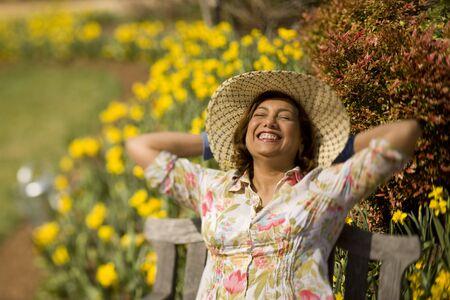 submerging: Hispanic woman wearing sun hat